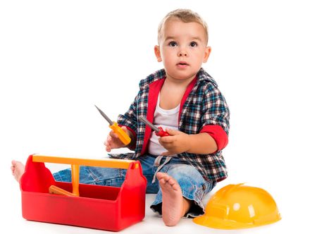 play: little boy playing toy tools isolated on white background