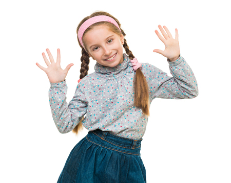 denim skirt: portrait of a cute little girl with her hands up isolated on white background