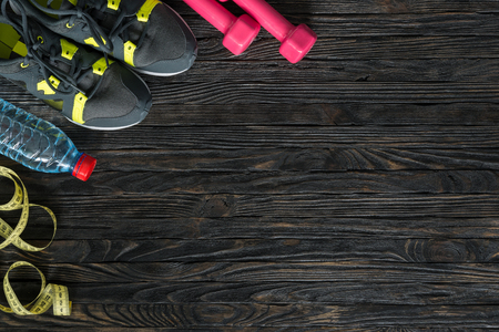 sport fitness items on dark wooden background with empty text space 免版税图像 - 50806268