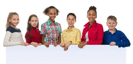complexion: children of different complexion holding an empty blank with thumbs up isolated on white background