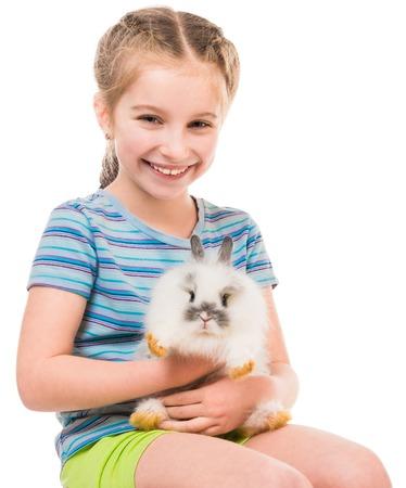 huevo blanco: Foto Pascua. Niña linda con un conejo aislados sobre fondo blanco Foto de archivo