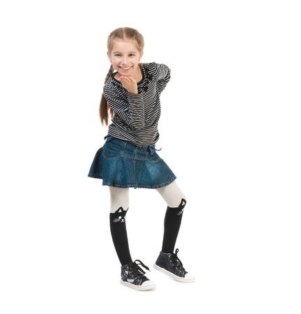 skirts: sonriente niña bonita en ropa de moda que soplan beso del aire aislado en el fondo blanco