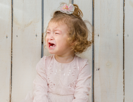 Children cry: offended little girl weeping with face turned away Kho ảnh