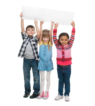 three children  holding empty sheet of paper isolated on white background Stock Photo