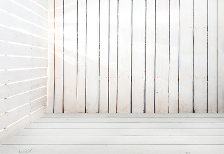 slits: empty white wooden room with light in slits between planks Stock Photo