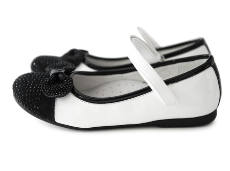 clasp feet: lovely black and white shoes for little girl isolated on white background Stock Photo