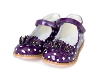 patent leather: nice spotted purple patent leather shoes for little girls, isolated on white background