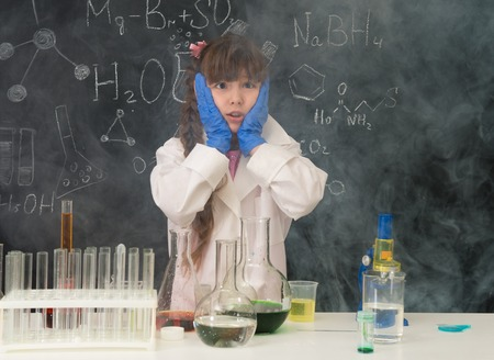 fume: excited schoolgirl in fume after chemical experiment in scool lab