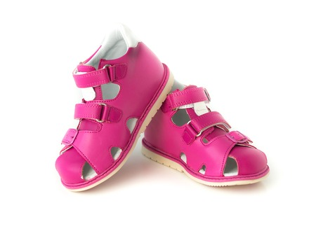 velcro: bright pink sandals for kids isolated on white background