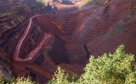source of iron: view inside the iron oxid quarry with trails on slopes in Krivyi Rih, Ukraine