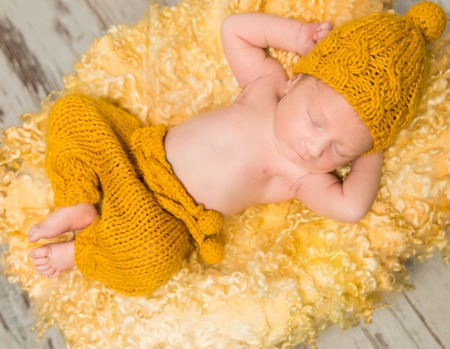 beautiful newborn baby lying on woolen blanket in wicker basket Фото со стока - 57713034
