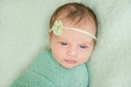 dream body: beautiful newborn girl in green close-up Stock Photo