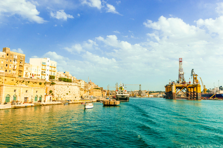picturesque view of Valletta and oil and gas floating platform in Malta bay