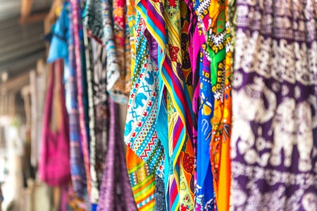 colorful patterned shawls and fabric at Zanzibar traditional street market, Africa