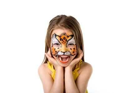 cute little girl with colorful painted face like tiger Фото со стока