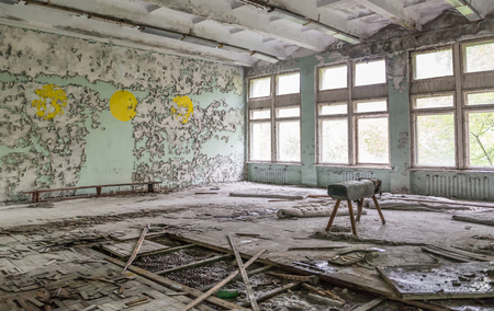 forsaken: ruined school gym with sports equipment remains and debris in Pripyat