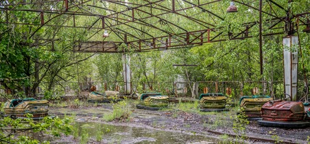 playground with rusty cars in abandoned Pripyat park Stock Photo