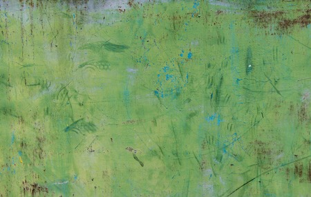 old dirty wall with green paint Stock Photo