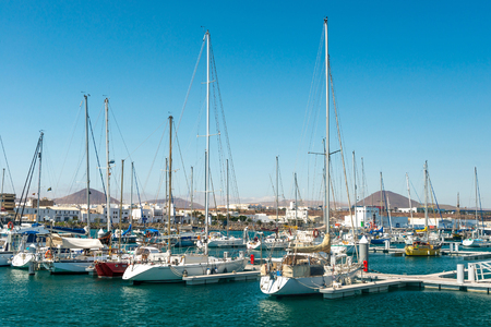 Yachts with their masts up in city harbor, Spain Stock Photo