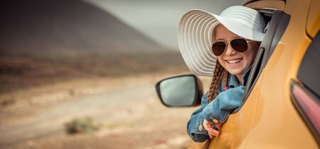 little girl traveling by car Stock Photo