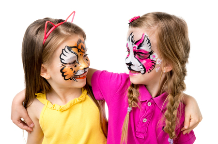 two little girls with painted faces 스톡 콘텐츠