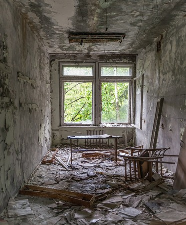 abandoned school study with debris and broken furniture