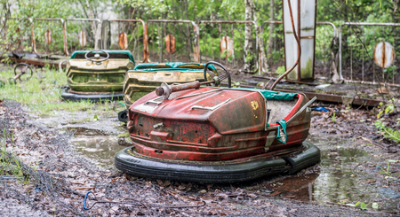 abandoned: obsolete rusty cars in Pripyat park