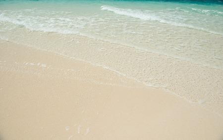 sandy beach and clear transparent sea wave