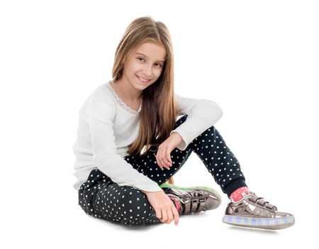 smiling teenage girl sitting on the floor Banco de Imagens