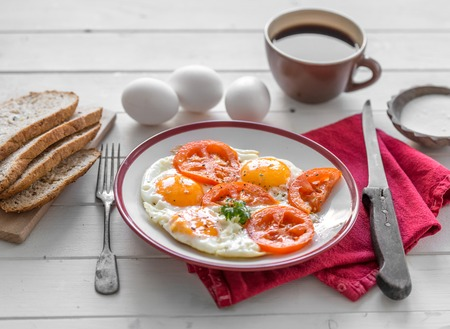 Eggs fried overeasy served on white plate