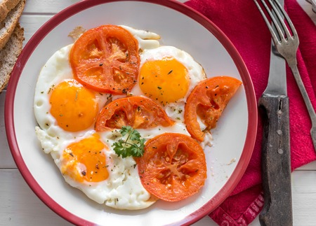 eggs with tomatoes served, topview