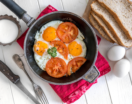 eggs overeasy in a frying pan, topview