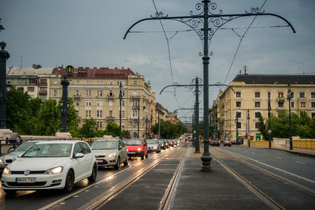 Cars moving down the street of Budapest Editorial