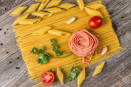 Spaghetti, rose looking macaroni in composition, topview Stock Photo