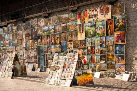 pictures on display on street of Krakow