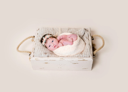 Infant with her eyes open widely Stock Photo