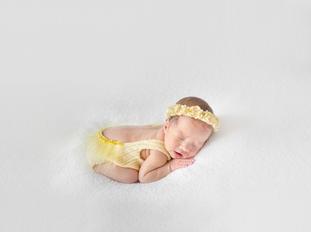 Kid in yellow knitted costume, closeup Stock Photo