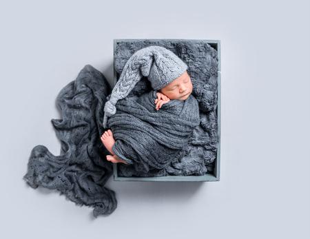 Newborn covered with dark blanket, topview Stock Photo