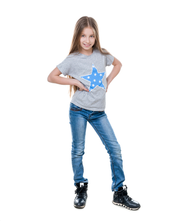 Preteen girl posing, isolated on white background Фото со стока
