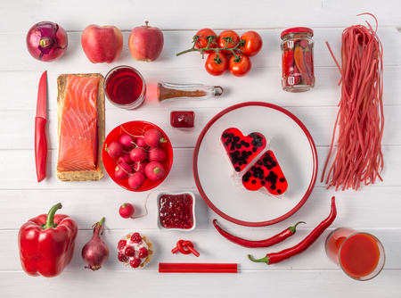 Set of red objects on white table, topview Stock Photo