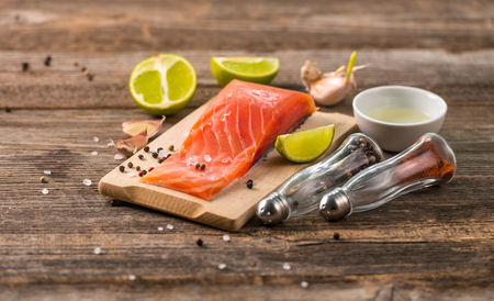 Salmon fillet on table with cut lemon Stock Photo