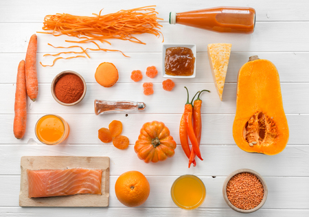 set of orange objects, pumpkin and carrots, topview Stock Photo