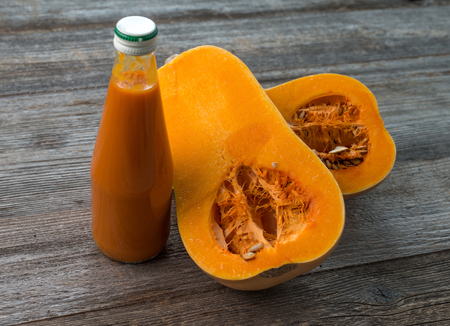 pumkin with seeds and bottle of juice