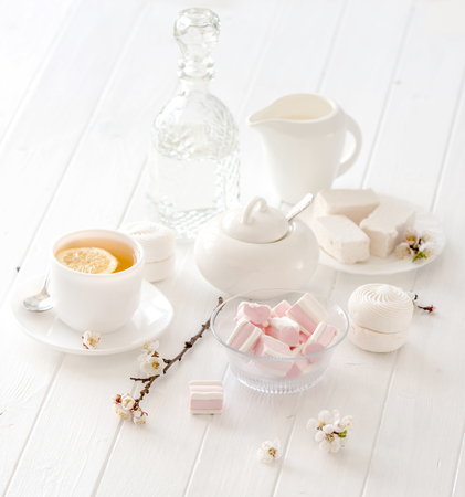 marshmellow: tea ceremony set with pink flowers and marshmellow