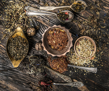 loose leaf: tea mixes in old-fashioned copper dishware, topview Stock Photo
