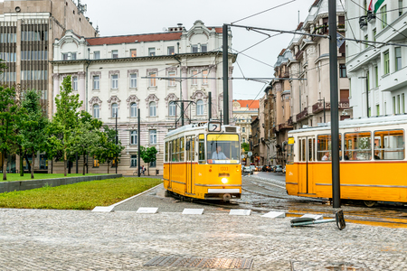yellow buses for public transportation in Hungary