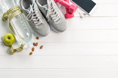 additional training: fitness equipment, diet food, space for text Stock Photo