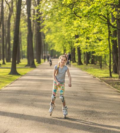 Teenage girl roller skating in colorful leggings