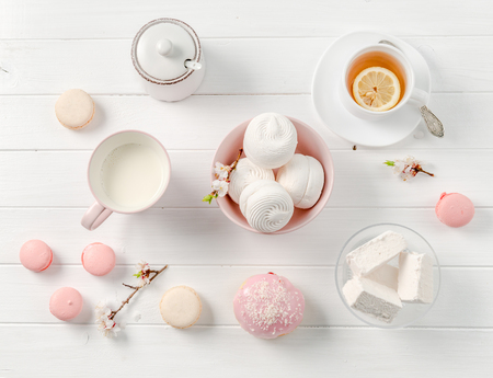 pastel sweets, tea and milk, topview