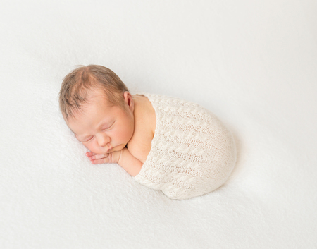 one sheet: Adorable child napping covered with scarf